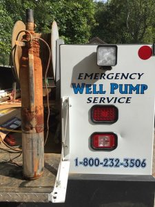 National Water Service Emergency Well Pump Truck with an old well water pump