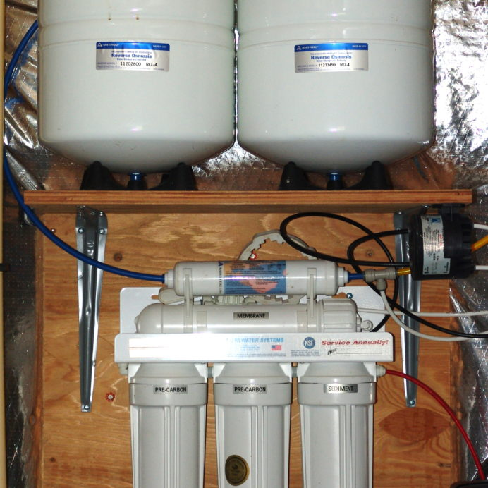 A Reverse Osmosis System for 99.9% contaminant free cooking & drinking water with a water pressure booster pump