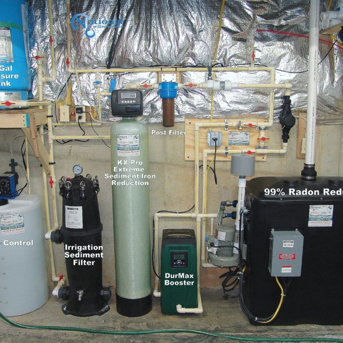 Whole House Water Treatment System, a raised Well Water Pressure Tank, a Solution Feeder for pH & corrosion control, a KX Pro Tank for extreme sediment & iron reduction, an Irrigation Sediment Filter, a Post-Treatment Sediment Filter, a Radon in Water remediation system with water pressure booster pump and a Reverse Osmosis System for 99.9% contaminant free cooking & drinking water