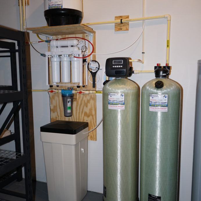City Water In-Home Water Treatment. A Reverse Osmosis for 99.9% contaminant free cooking & drinking water, a  Water Softener for Hard Water and a Carbon Tank.