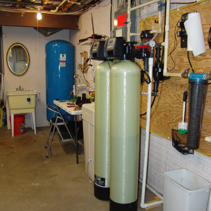Well Water Pressure Tank, a Water Softener with Brine Tank , an Acid Neutralizer and a Whole House Sediment Filter