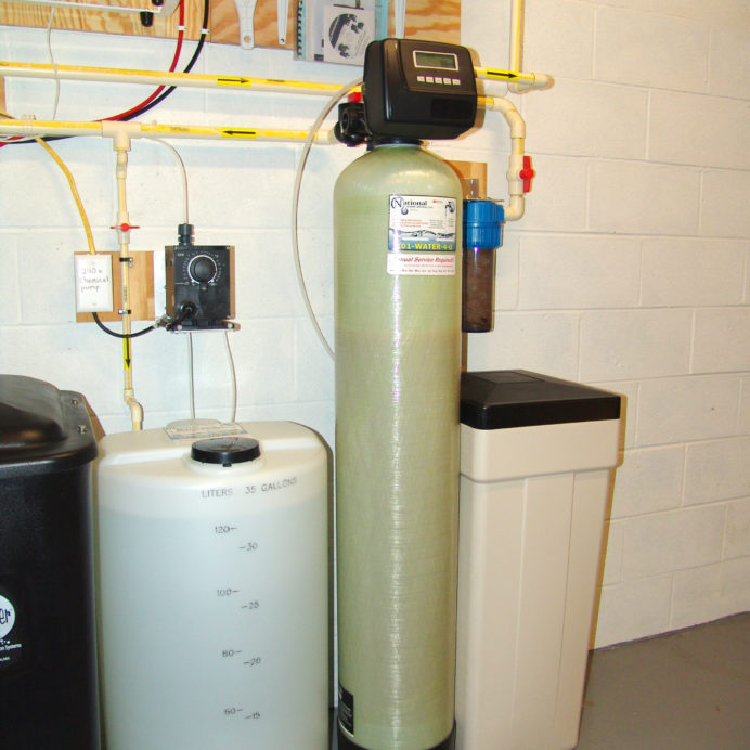 Water Softener with Brine Tank for hard water, a Chemical Feeder for pH control, a Reverse Osmosis for contaminant free drinking water & a Whole House Sediment Filter