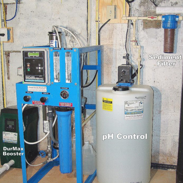 Whole House Commercial Grade Reverse Osmosis System for 99.9% contaminant free water with a water pressure booster pump, a Chemical Feeder for corrosion and pH control & a sediment filter