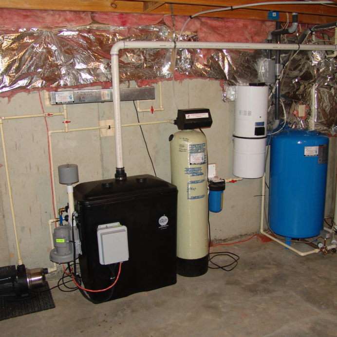 A Radon Reduction System for the remediation of cancer causing radon in water with a Water Pressure Booster Pump, an Acid Neutralizer for pH control, a Whole House Sediment Filter, a Pressure Tank and a Hot Water Heater
