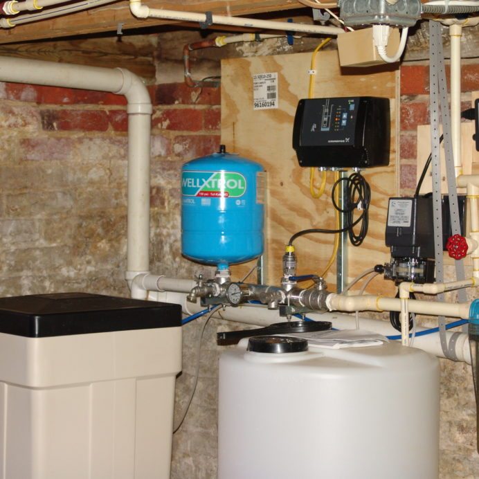 A Brine Tank for a Water Softener, a Constant Water Pressure System, a Chemical feeder and Solution Tank for pH and corrosion control, a Whole House Sediment Filter