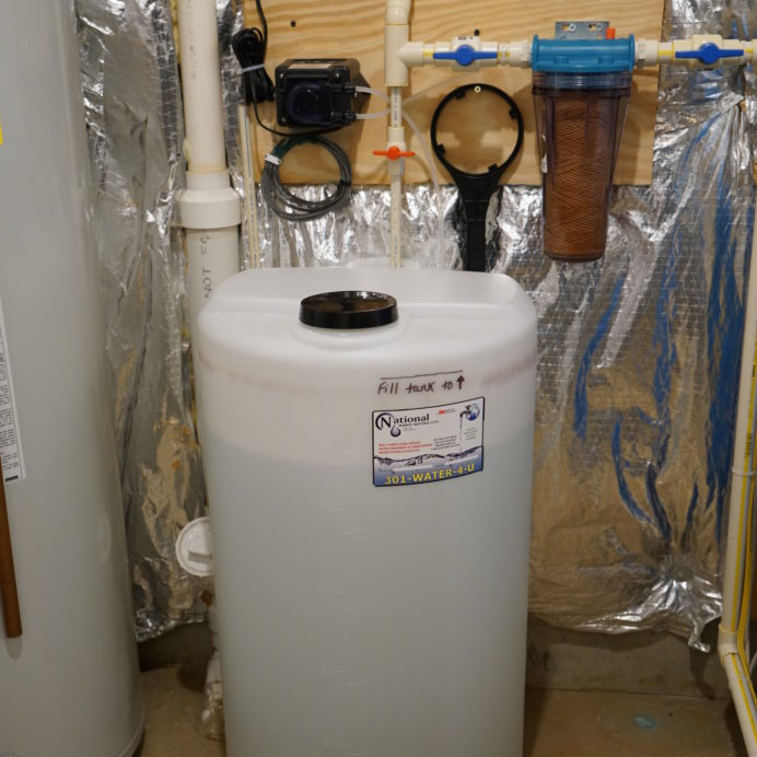 A Chemical Feeder and Solution Tank for pH and corrosion control and a Whole House Sediment Filter