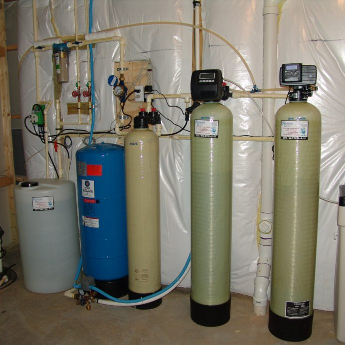 A Chemical Feeder Pump and Solution Tank for pH and corrosion control, a  Whole House Sediment Filter, a Pressure Tank, a Mixer Tank, a Water Softener and Brine Tank for hard water and an Iron Breaker