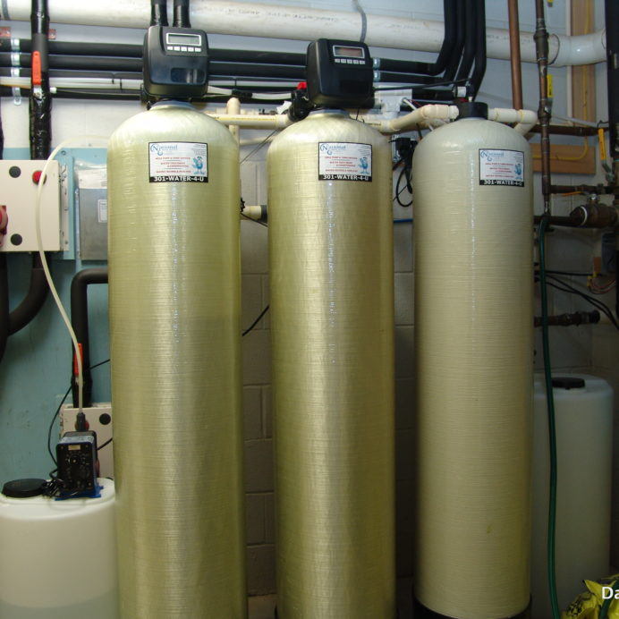 A Water Softener with brine tank for hard water, an Acid Neutralizer & Chemical Feeder for pH & corrosion control and a Carbon Tank for the removal of low levels of radon in water