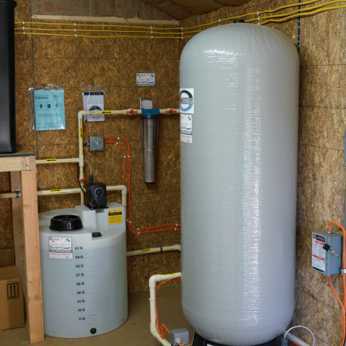 An extra large Solution Tank and Chemical Feeder Pump for pH and corrosion control, a Whole House Sediment Filter and a Pressure Tank