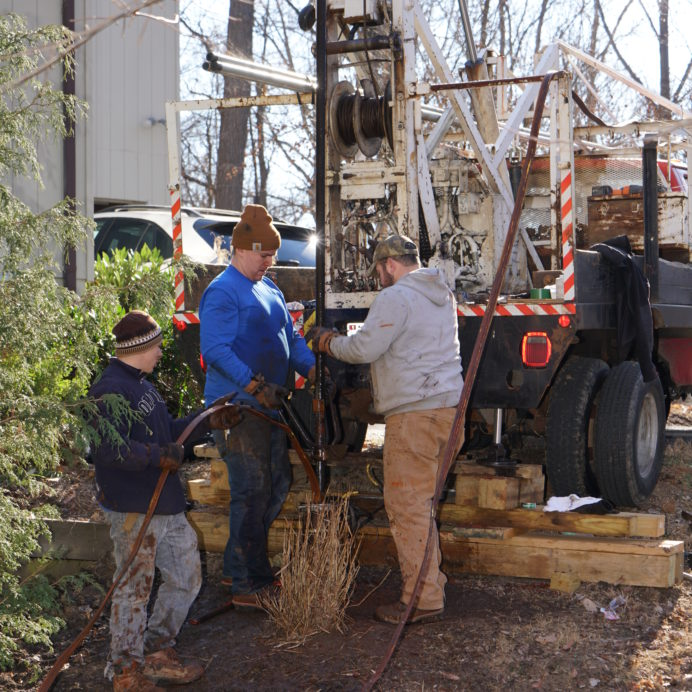 Our hoist truck pulling up Hard Pipe to reach a broken Well Water Pump