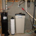 An Irrigation Sediment Filter, a Water Softener and a Brine Tank and a post treatment Sediment Filter