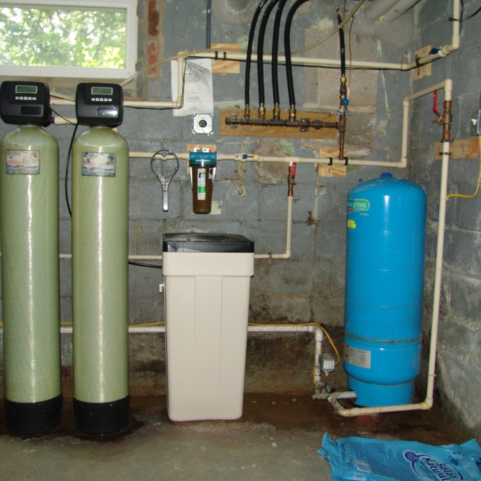 A Multi-Media Tank, a Water Softener, A Whole House Sediment Filter, a Pressure Tank and an Ultraviolet Light for the disinfection of bacteria and virus' in water
