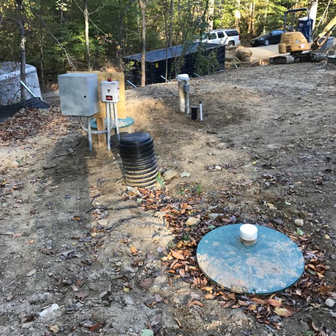 Well Cap & Casing and Service Hatch for two underground, buried Water Storage Tanks