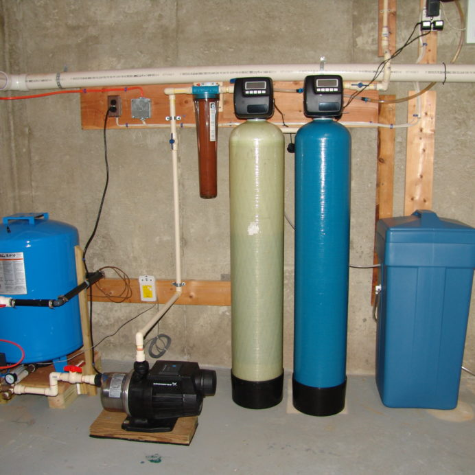 A raised Pressure Tank with a Grunfos Water Pressure Booster Pump, a Whole House Sediment Filter, a Iron Filter, a Water Softener and a Brine Tank