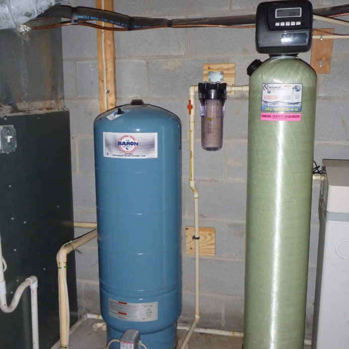 A Pressure Tank, a Whole House Sediment Filter and an Acid Neutralizer