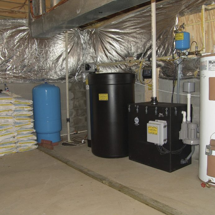 A Pressure Tank, A Water Softener and Commercial Brine Tank, a Radon Reduction System for the remediation of cancer causing radon in water and a Water Heater