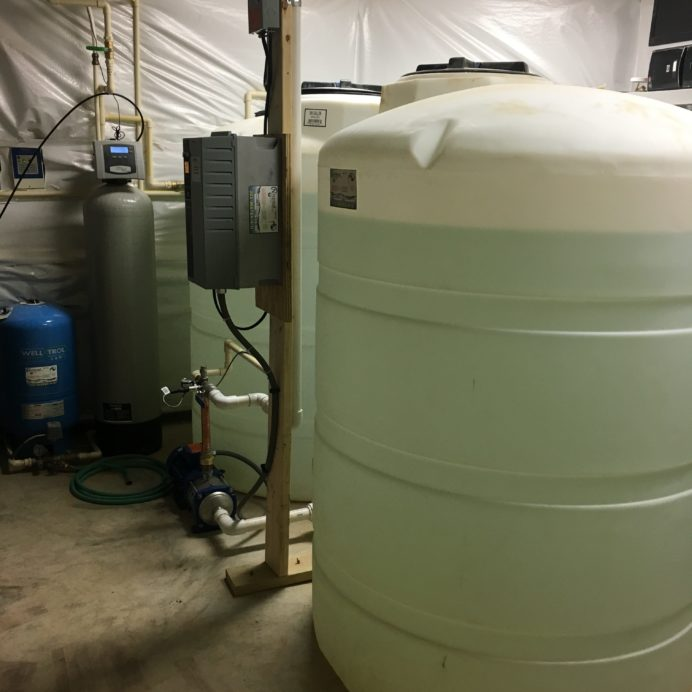 A Pressure Tank, A Water Softener, two Water Storage Tanks with a Water Pressure Re-Booster and a Pump Controller