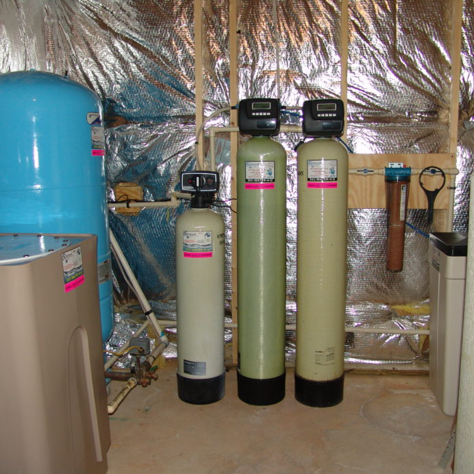 A Radon Reduction System for the remediation of cancer causing radon in water, a Pressure Tank, a Water Softener and Brine Tank for hard water, an Acid Neutralizer for pH control, a Mixing Tank and a Sediment Filter