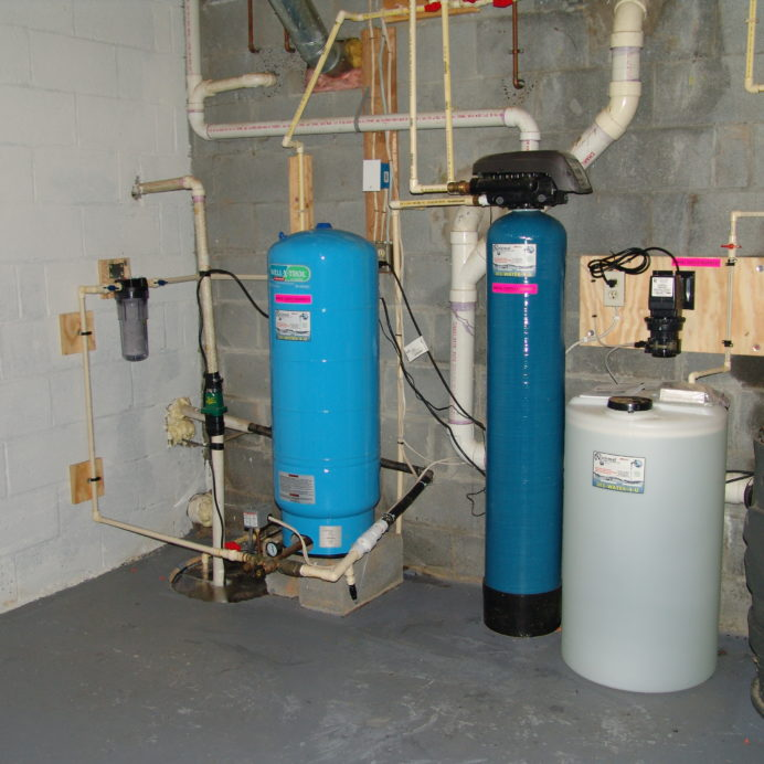 A Whole House Sediment Filter, a Sump Pump, a Pressure Tank, a Mixing Tank and a Chemical Feeder and Solution Tank