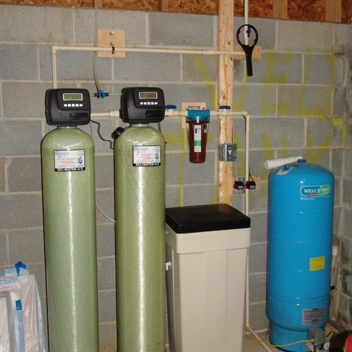 A Water Softener and Brine Tank for hard water, an Acid Neutralizer for pH and corrosion control, a Whole House Sediment Filter and a Pressure Tank