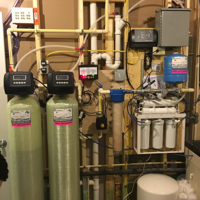 A Water Softener for hard water, an Acid Neutralizer for pH and corrosion control, an online Flood Protection System, a Whole House Sediment Filter, a Reverse Osmosis System for 99.9% contamination free drinking water with lines to kitchen and a Constant Water Pressure System