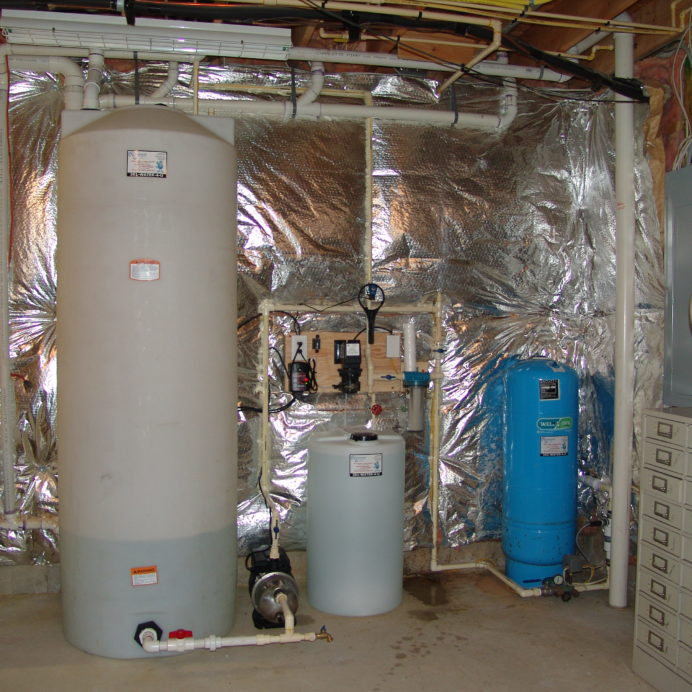 A Water Storage Tank, a water Re-Booster, a leak detection Alarm, a Chemical Feeder Pump and Solution Tank for pH and corrosion control, a Whole House Sediment Filter and a Pressure Tank