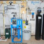 storage tanks, a whole house reverse osmosis, a Solution feeder, a water softener, a turbidity filter and an ozone filter