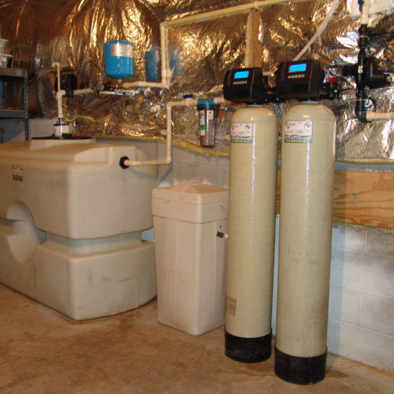 Water Storage Tanks, Constant Water Pressure System, a Whole House Sediment Filter, Water Softener and Brine Tank, Iron and Sulfur Breaker