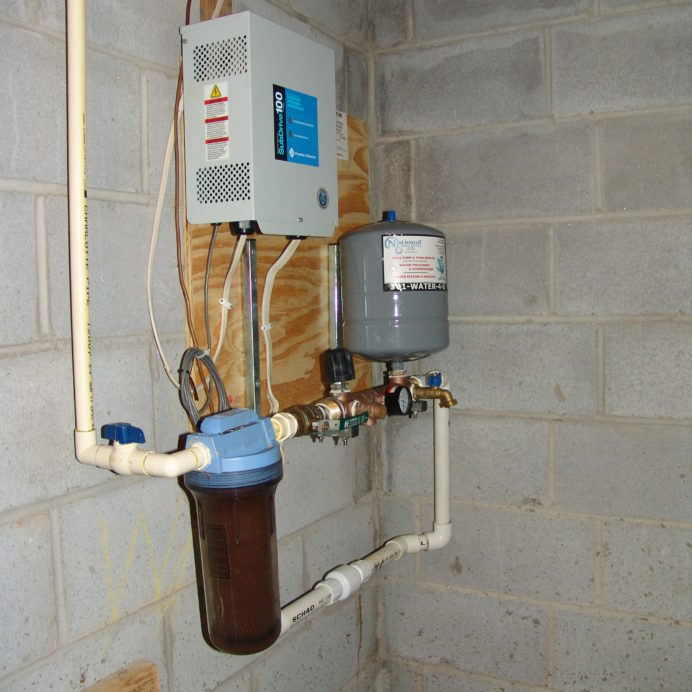 Well Pump Constant Water Pressure Control Center and a Whole House Sediment Filter