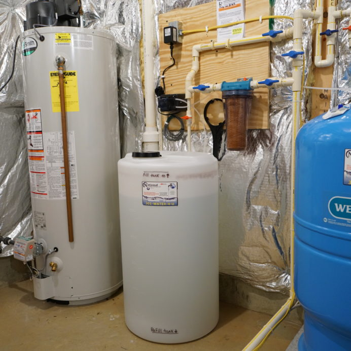 A Hot Water Heater, a Chemical Feeder for pH & corrosion control, a Whole House Sediment Filter & a Well Water Pressure Tank