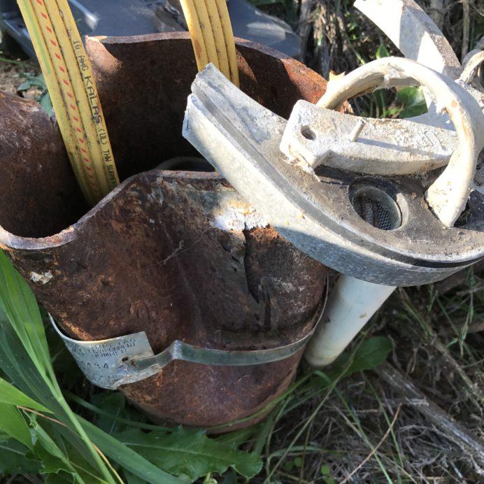 A broken Well Cap, Casing and Conduit