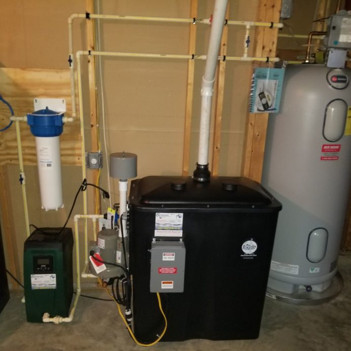 Installation of a Radon Remediation System, Booster Pump, Whole House Sediment Filter and a Hot Water Heater