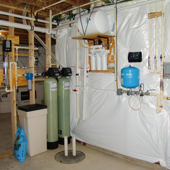 Water Softener with a Brine Tank for hard water, a Multi-Media tank for sediment and turbidity, an Ultraviolet Light for bacteria remediation, a 75 gallon per day Reverse Osmosis System for up to 99.9% contaminant free drinking water, a 10 inch Whole House Sediment Filter, a Constant Water Pressure Well Pump & Control Box