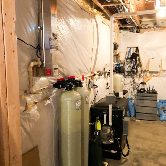 Ultraviolet water purification system to remove bacteria from water & Twin Carbon Tanks for the removal of Chlorine, Radon, odor & more, An AirRaider for the remediation of Radon in Water, a Chemical Feeder for pH & corrosion control, a Water Softener for hard water & a constant well water pressure tank & manifold