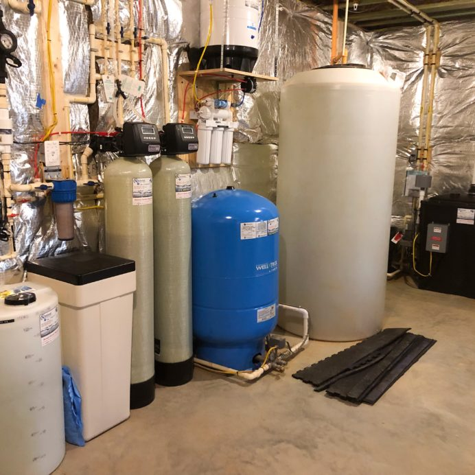 Chemical Feeder for corrosion & pH, Water Softener for hard water, a Birm Tank for iron, a Reverse Osmosis for up too 99% contaminant free drinking water, a pressure tank, Radon in water remediation system and 400 gallon clean water storage tank