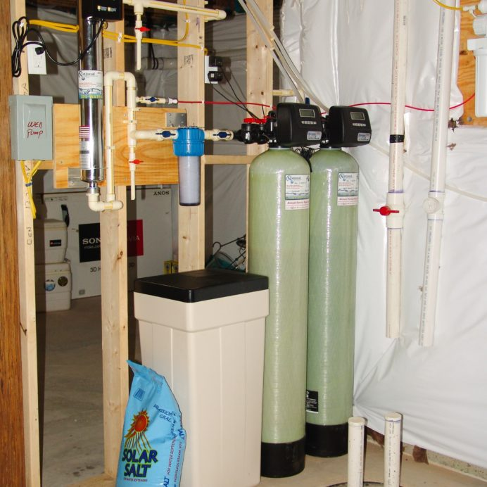 Water Softener with a Brine Tank for hard water, a Multi-Media tank for sediment and turbidity, an Ultraviolet Light for bacteria remediation & a Sediment Filter