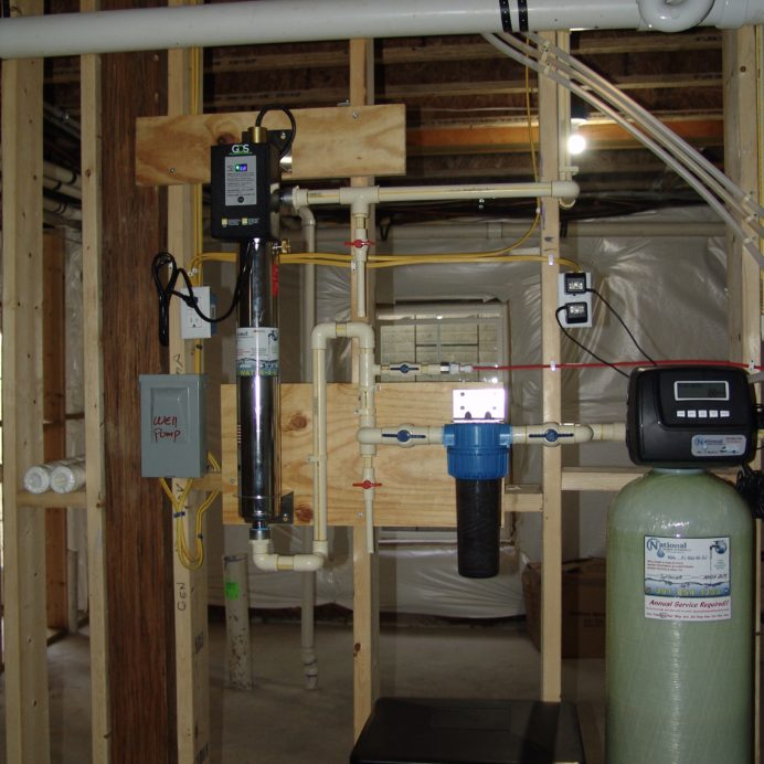 Water Softener with a Brine Tank for hard water, an Ultraviolet Light for bacteria remediation & a Sediment Filter