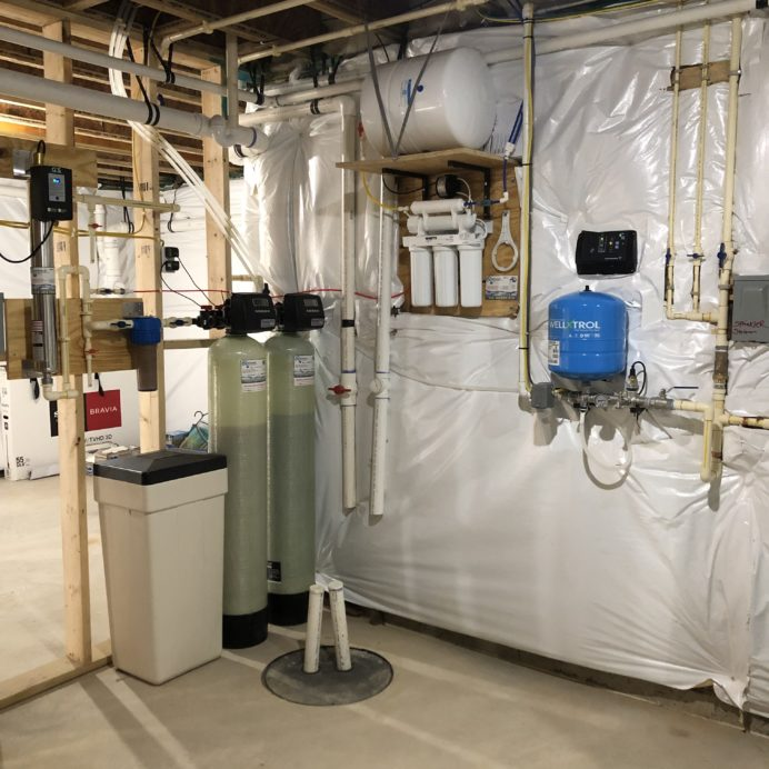We installed a Water Softener with a Brine Tank for hard water, a Multi-Media tank for sediment and turbidity, an Ultraviolet Light for bacteria remediation, a 75 gallon per day Reverse Osmosis System for up to 99.9% contaminant free drinking water, a 10 inch Whole House Sediment Filter, a Constant Water Pressure Well Pump & Control Box & two Hot Water Heaters for a very happy new customer!