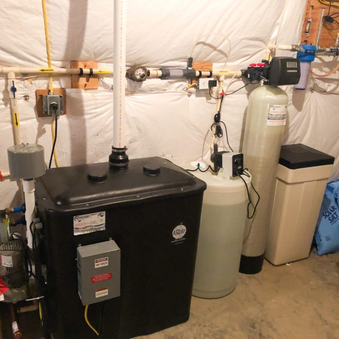 An AirRaider for the remediation of Radon in Water, a Chemical Feeder for pH & corrosion control, a Water Softener for hard water & a constant well water pressure tank & manifold
