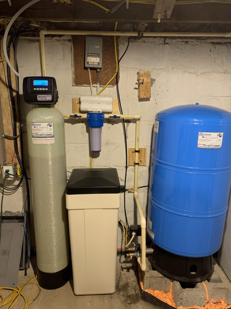 Pressure tank, water softener for hard water and a sediment filter