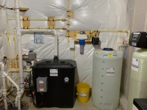 Sump Pump, Radon removal system with a pressure booster, a sediment filter, Solution feeder and a water softener