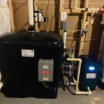 radon remediation system with a pressure booster