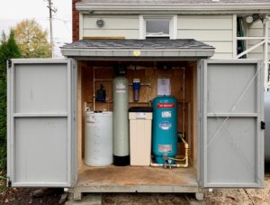 A Solution Feeder, water softener, a sediment filter and a pressure tank in a shed
