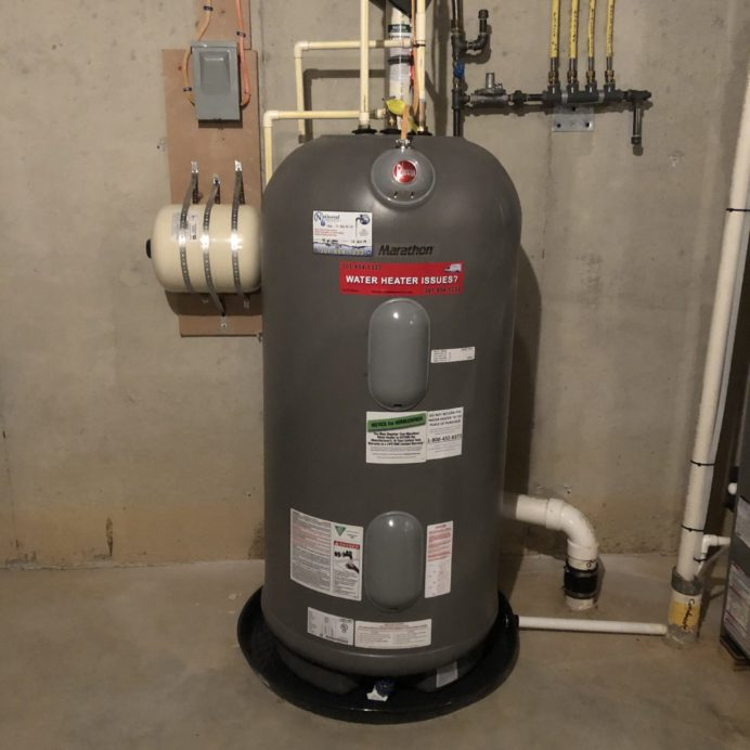 a Marathon Gas Water Heater with a leak protection pan and an expansion tank